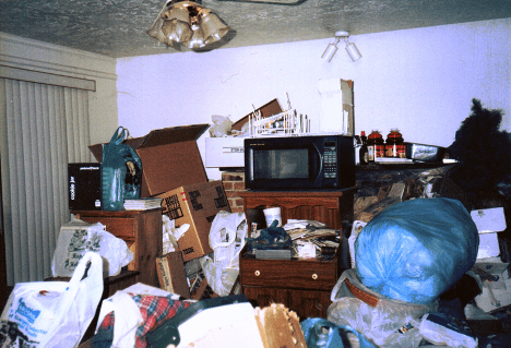 Photo of a hoarder home, filled with clutter that can make it dangerous and difficult to sell.