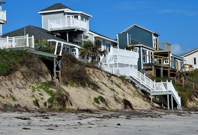 Homes on the coast affected by hurricane damage.