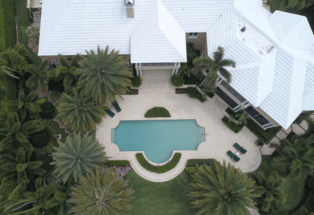 Aerial photo of a home with a pool.